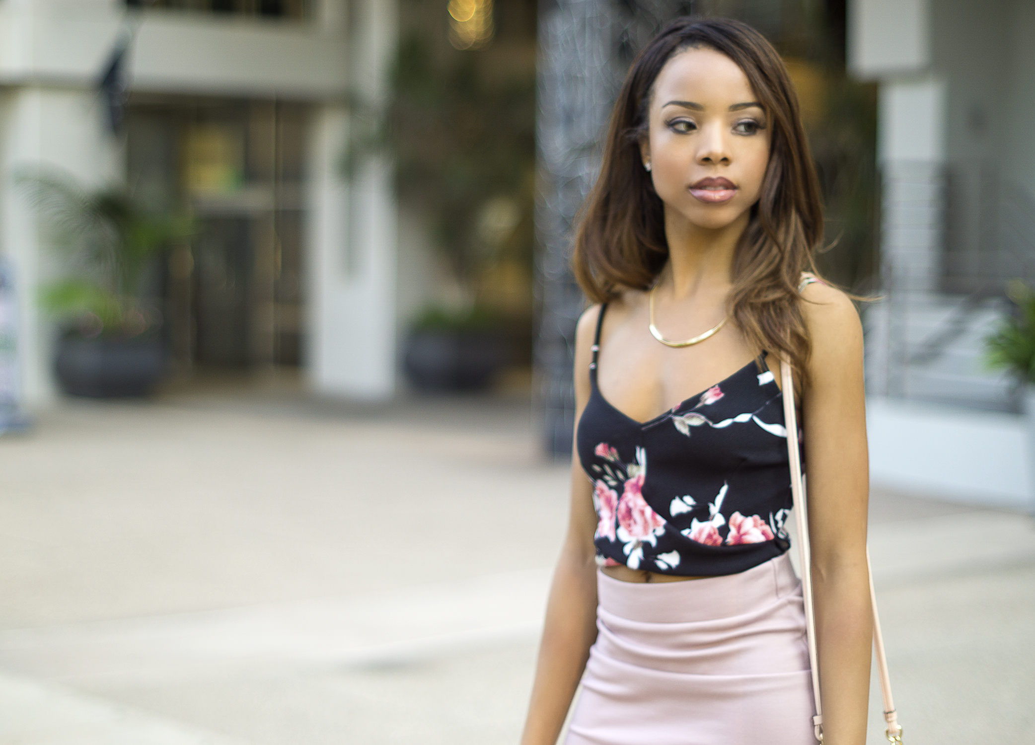 black and pink floral corp top, pink high waisted skirt